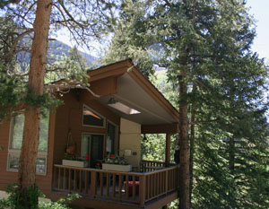 this home overlooks Bighorn Creek and it's namesakes trailhead.